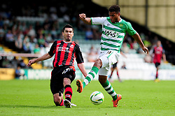 Bournemouth's Richard Hughes challenges Yeovil Town's Reuben Reid - Photo mandatory by-line: Dougie Allward/Josephmeredith.com  - Tel: Mobile:07966 386802 08/09/2012 - SPORT - FOOTBALL - League 1 -  Yeovil  - Huish Park -  Yeovil Town v AFC Bournemouth