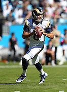 St. Louis Rams quarterback Sam Bradford (8) scrambles and throws a completed pass on the Rams second drive during the NFL week 7 football game against the Carolina Panthers on Sunday, Oct. 20, 2013 in Charlotte, N.C.. The Panthers won the game 30-15. ©Paul Anthony Spinelli