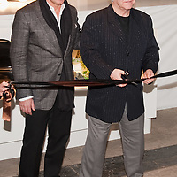LONDON - DECEMBER 11: Sir Elton John and partner David Furnish cut the ribbon at a photocall to open a pop-up shop in Covent Garden, on December 11, 2009 in London, England. The shop will sell clothes from Elton John and David Furnish's wardrobes in aid of the Elton John AIDS Foundation. (Photo by Marco Secchi/Getty Images)