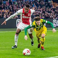 AMSTERDAM - Ajax - ADO , Voetbal , Eredivisie , Seizoen 2016/2017 , Amsterdam ArenA , 29-01-2017 ,  eindstand 3-0 , Ajax speler Mateo Cassierra (l) in duel met ADO Den Haag speler Danny Bakker (r)