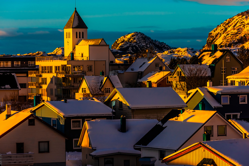 Early morning light on snow covered rooftops in Svolvaer, Austvagoya Island, Lofoten Islands, Arctic, Northern Norway.
