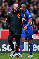 Ashley Young of Manchester United is helped off the pitch after pulling up injured holding his leg - Photo mandatory by-line: Rogan Thomson/JMP - 07966 386802 - 01/01/2015 - SPORT - FOOTBALL - Stoke-on-Trent, England - Britannia Stadium - Stoke City v Manchester United - New Year's Day Football - Barclays Premier League.
