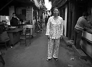 A woman in her pajamas in Shanghai.