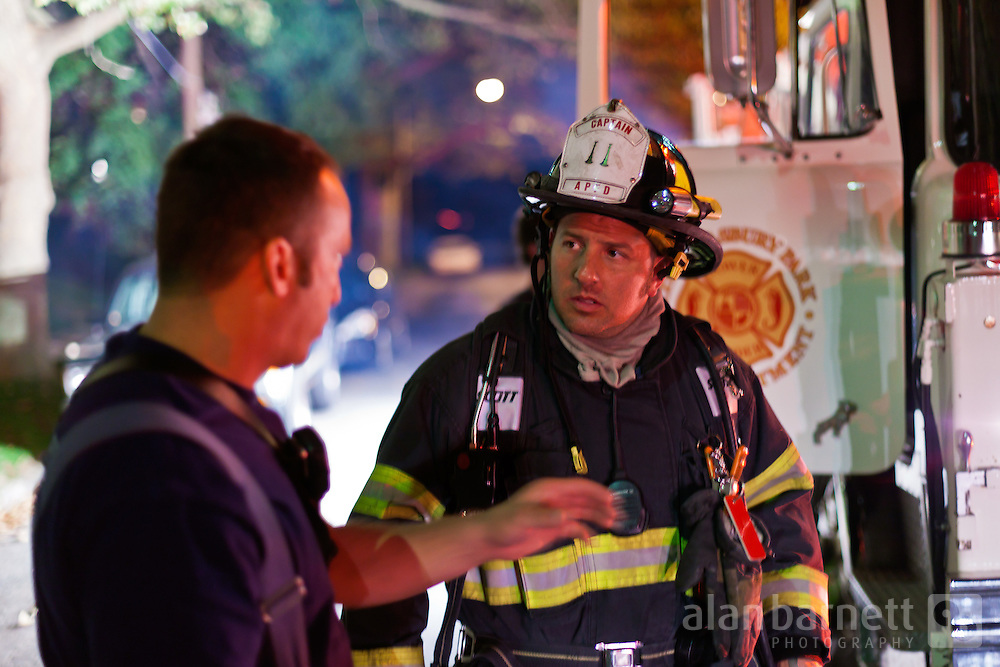 Firefighters in conversation at the scene of a call.