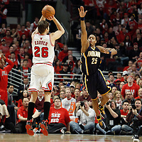 16 April 2011: Chicago Bulls shooting guard Kyle Korver (26) takes a jumpshot over Indiana Pacers shooting guard Brandon Rush (25) during the Chicago Bulls 104-99 victory over the Indiana Pacers, during the game 1 of the Eastern Conference first round at the United Center, Chicago, Illinois, USA.
