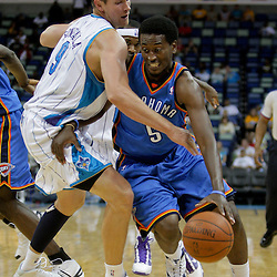 Oct 10, 2009; New Orleans, LA, USA; Oklahoma City Thunder guard Kyle Weaver (5) drives past New Orleans Hornets center Darius Songaila (9) during the second half at the New Orleans Arena. The Hornets defeated the Thunder 88-79. Mandatory Credit: Derick E. Hingle-US PRESSWIRE