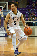 FORT WORTH, TX - JANUARY 7: Kyan Anderson #5 of the TCU Horned Frogs brings the ball up court against the Kansas State Wildcats on January 7, 2014 at Daniel-Meyer Coliseum in Fort Worth, Texas.  (Photo by Cooper Neill/Getty Images) *** Local Caption *** Kyan Anderson