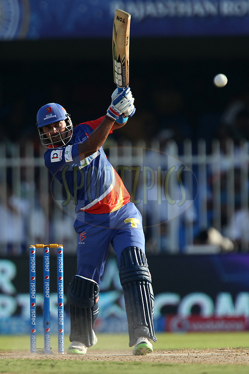 Murali Vijay of the Delhi Daredevils drives down the ground for four during match 16 of the Pepsi Indian Premier League 2014 between the Delhi Daredevils and the Mumbai Indians held at the Sharjah Cricket Stadium, Sharjah, United Arab Emirates on the 27th April 2014<br /> <br /> Photo by Ron Gaunt / IPL / SPORTZPICS