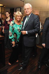 MARTYN LEWIS and PATSY BAKER at a Valentine's Party in aid of Chickenshed held at De Beers, 50 Old Bond Street, London W1 on 6th Fbruary 2008.<br />