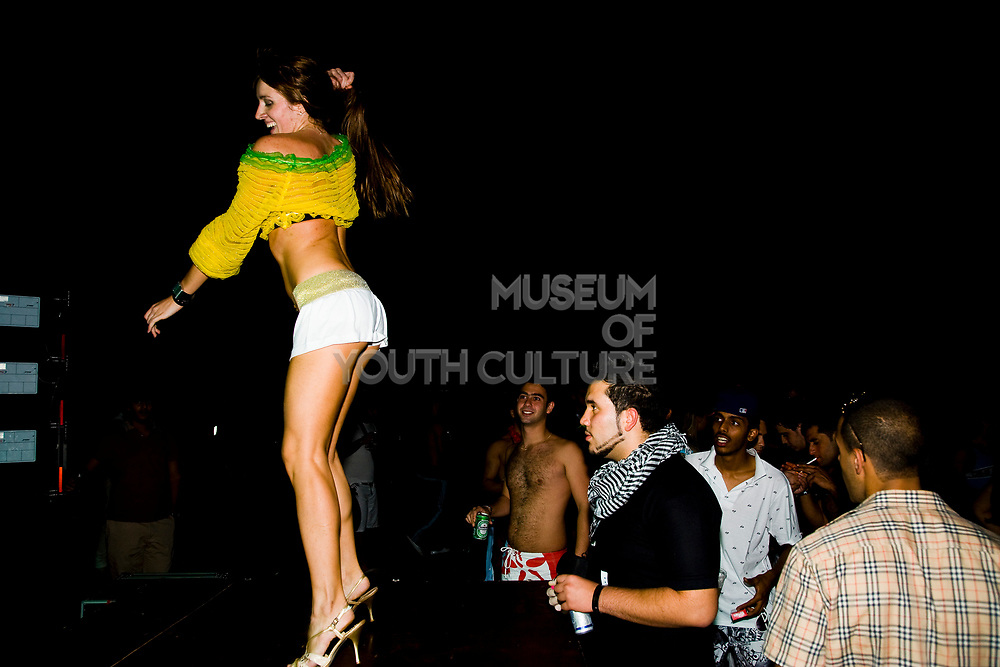 A man staring at a woman's bottom as she dances. Friday 14th of Nov 2008- The first dance festival in the Middle East. Coma festival, Al Maya Island, Abu Dhabi, UAE. Middle East