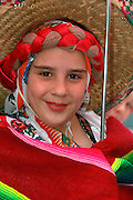 Performer age 13 in traditional dress at Cinco de Mayo festival.  St Paul Minnesota USA