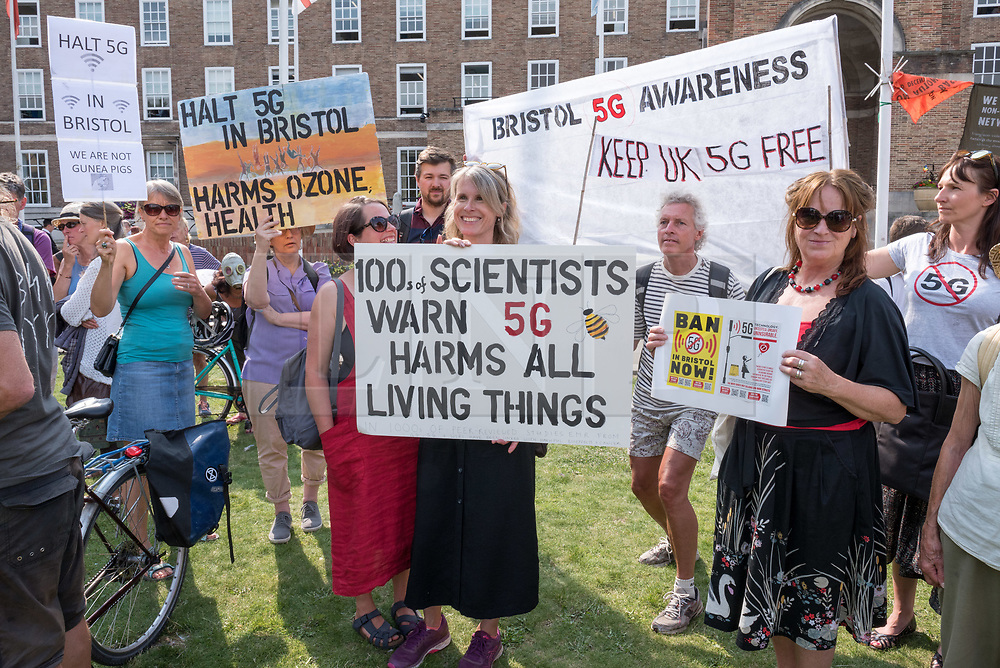 © Licensed to London News Pictures. 16/07/2019; Bristol, UK. A protest against the roll out of 5G mobile phone transmission signals takes place at City Hall in Bristol. Campaigners say that studies show that the 5G microwave signal radiation levels are harmful to health and want the 5G network halted. Photo credit: Simon Chapman/LNP.