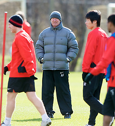 MANCHESTER, ENGLAND - Monday, March 3, 2008: Manchester United's manager Alex Ferguson watches his side training at Carrington ahead of the UEFA Champions League First knockout round 2nd leg match against Olympique Lyonnais. (Photo by David Rawcliffe/Propaganda)