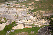 Man walking on footpath River Tajo limestone gorge cliffs, Alhama de Granada, Spain