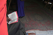 Israel, Jerusalem church of the holy sepulchre Ethiopian Orthodox priest holding a prayer book, Palm Sunday Easter 2005