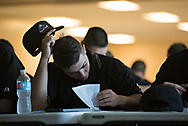 Adam Cortes studies the rule book which students are tested on extensively at the Wendelstedt Umpire School.