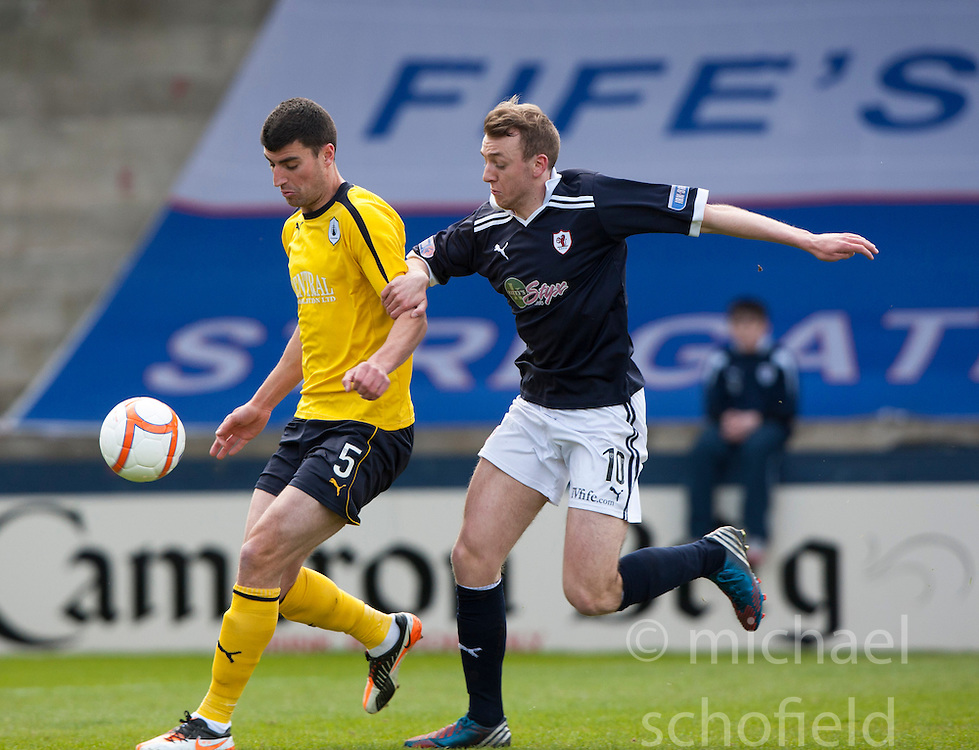 Falkirk's Johnny Flynn  and Raith Rovers Greig Spence..Raith Rovers 0 v 0 Falkirk, 27/4/2013..© Michael Schofield.