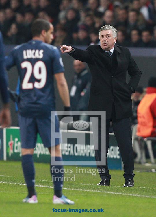 Picture by Paul Terry/Focus Images Ltd +44 7545 642257.02/04/2013.Carlo Ancelotti ( R ) of Paris Saint-Germain gives instructions during the UEFA Champions League match at Parc des Princes, Paris.