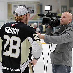 TRENTON, ON  - MAY 6,  2017: Canadian Junior Hockey League, Central Canadian Jr. &quot;A&quot; Championship. The Dudley Hewitt Cup Championship Game between The Trenton Golden Hawks and The Georgetown Raiders. Lucas Brown #28 of the Trenton Golden Hawks interviewed by OJ Today during post game celebrations. <br /> (Photo by Amy Deroche / OJHL Images)