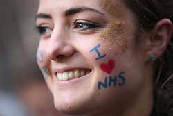 © Licensed to London News Pictures. 09/01/2016. London, UK.  Student nurse Sarah Ball takes part in a rally against the proposed cancellation of bursaries for nurses hoping to train for work in the NHS.  Photo credit: Peter Macdiarmid/LNP