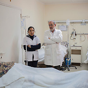Italian doctor Pietro Gamba during a routine morning check at his hospital in Anzaldo, in the Bolivian Andes