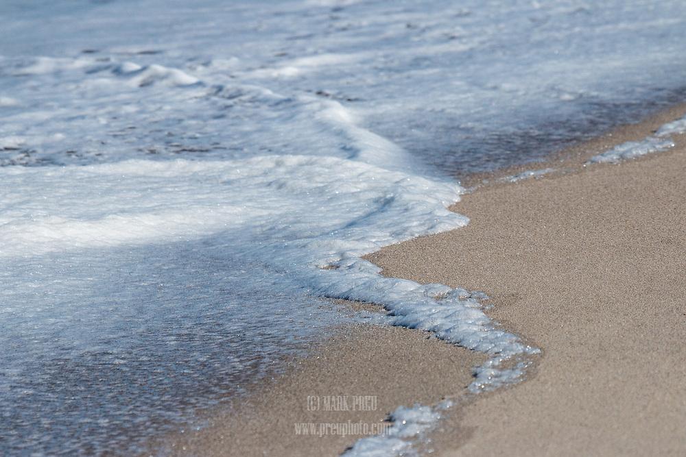 Sea foam left by a retreating wave