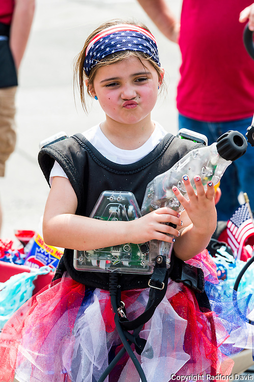 Girl with water gun at the Fourth of July parade in Ames, Iowa