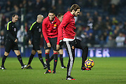 Daley Blind Midfielder of Manchester United in warm up with Chris Smalling Defender of Manchester United in background smiling during the Premier League match between West Bromwich Albion and Manchester United at The Hawthorns, West Bromwich, England on 17 December 2016. Photo by Phil Duncan.
