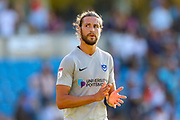 Portsmouth defender Christian Burgess (6) thanks the travelling fans during the EFL Sky Bet League 1 match between Wycombe Wanderers and Portsmouth at Adams Park, High Wycombe, England on 21 September 2019.