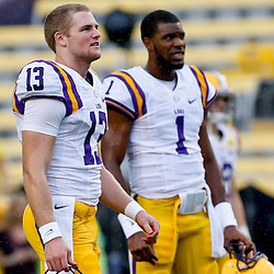 Sep 21, 2013; Baton Rouge, LA, USA; LSU Tigers quarterback Jake Clise (13) and quarterback Rob Bolden (1) before a game against the Auburn Tigers at Tiger Stadium. Mandatory Credit: Derick E. Hingle-USA TODAY Sports