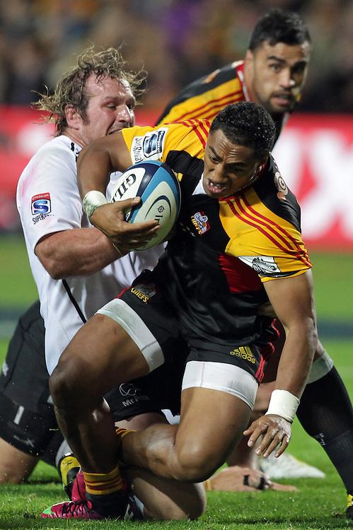 Chiefs' Bundee Aki is tackled by Sharks' Jannie du Plessis in a Super Rugby match, Waikato Stadium, Hamilton, New Zealand, Saturday, April 27, 2013.  Credit:SNPA / David Rowland