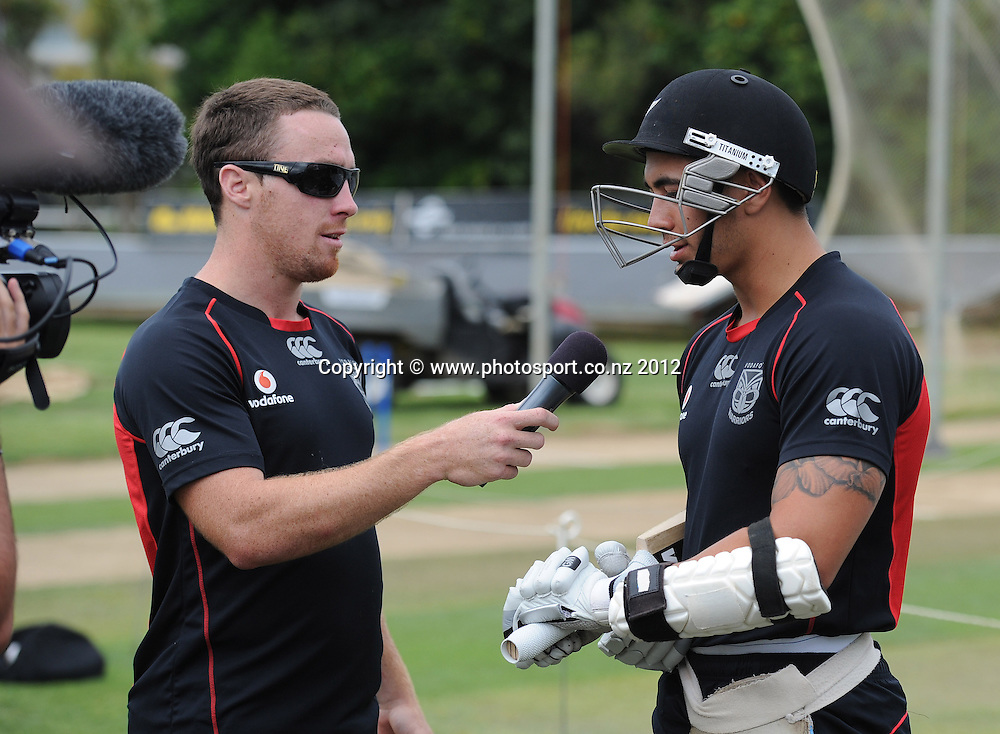 James Maloney interviews Shaun Johnson as the Vodafone Warriors joined the New Zealand Black Caps for a training session at Colin Maiden Oval, Auckland on Tuesday 21 February 2012. Photo: Andrew Cornaga/Photosport.co.nz