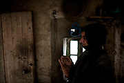 """I do not feel as man. The clothes that I use are those of a woman, the works I do are those who make other women out here. Sometimes the shepherds who come down from the mountains knocking on my door, I have sex with them"". Larshen is a transsexual of 55 years old, in addition to prostitute sells loose cigarettes..January 2010, Tamsult, Anti-Atlas mountains, Morocco. Tamsult is the name of an old souk, which today has no more business, only walled boutiques. This place is known by all as the crossroads for sex, linking various villages in the mountains around.....The misery of a square bare, dirt, dotted with broken glass and cans, brick structures close the doors of old shops, stray dogs and the ghosts of women who inhabit it. Are Taidit, are ""bitches"", are prostitutes and are the renters of an old souk abandoned at 1200 meters in the heart of the Anti-Atlas Mountains of Morocco. The time when the market was full of merchants and sellers gave place to the vendors of their own bodies...To protect the identities of the recorded subjects names are fictional."