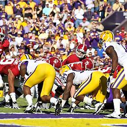 November 6, 2010; Baton Rouge, LA, USA; Alabama Crimson Tide quarterback Greg McElroy (12) under center during the first half against the LSU Tigers at Tiger Stadium.  Mandatory Credit: Derick E. Hingle