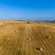 Aerial rolled hay farmland fields countryside landscape in Alentejo, tourism destination region, Portugal.