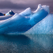 Jökulsárlón is a large glacial lagoon in southeast Iceland bordering Vatnajökull National Park. The lagoon is situated at the head of Breiðamerkurjökull glacier.