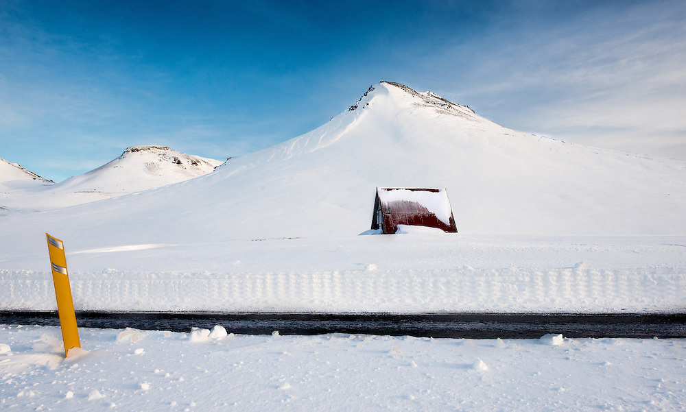 This shack, found on an unknown road in Iceland was well and truely buried by snow.  Its sometimes hard to visualise just how deep that show is! <br />