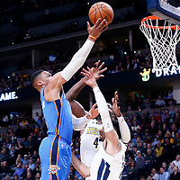 09 November 2017: Oklahoma City Thunder guard Russell Westbrook (0) goes for the layup against Denver Nuggets forward Paul Millsap (4) and Denver Nuggets guard Jamal Murray (27) during the Denver Nuggets 102-94 victory over the Oklahoma City Thunder, at the Pepsi Center, Denver, Colorado, USA.