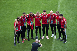LYON, FRANCE - Tuesday, July 5, 2016: Wales players pose for a photograph during a training session ahead of their UEFA Euro 2016 Championship Semi-Final match against Portugal at the Stade de Lyon. LtR: Joe Allen, Hal Robson-Kanu, captain Ashley Williams, George Williams, James Chester, David Cotterill, Simon Church and Neil Taylor. (Pic by Paul Greenwood/Propaganda)