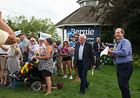 Democratic Presidential candidate Bernie Sanders is welcomed by the crowd gathered at the Wolfeboro Inn on Monday evening.  (Karen Bobotas/for the Laconia Daily Sun)