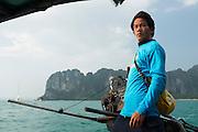 Portrait of longtail boat driver near Railay Beach, Thailand.