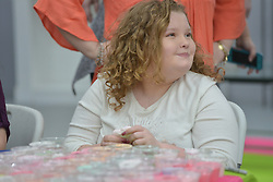 "EXCLUSIVE: June Shannon (Mama June) and her daughters, Alana Thompson (Honey Boo Boo) and Lauryn Shannon (Pumpkin) and her boyfriend, Josh Efird, their 2 month old daughter, Ella Grace Efird, sister JoAnne Shannon (Doe Doe), and niece Amber Busby and other family members raise money for the Children's Hospital of Macon in Hampton, Ga. on February 18, 2018. They had a fan meet and greet at Last Chance Liquidators, Doe Doe's store. They sold raffle tickets for mystery boxes of products, homemade slime, and signed posters of their new television show on the WE network, ""Mama June, From Not to Hot"". Alana stayed up to 5 a.m to make 450 jars of slime. They are donating half the proceeds and garnering more support on social media for the cause. 18 Feb 2018 Pictured: June Shannon (Mama June) and her daughters, Alana Thompson (Honey Boo Boo) and Lauryn Shannon (Pumpkin) and her boyfriend, Josh Efird, their 2 month old daughter, Ella Grace Efird, sister JoAnne Shannon (Doe Doe), and niece Amber Busby and other family members raise money for the Children's Hospital of Macon in Hampton, Ga. on February 18, 2018. They had a fan meet and greet at Last Chance Liquidators, Doe Doe's store. They sold raffle tickets for mystery boxes of products, homemade slime, and signed posters of their new television show on the WE network, ""Mama June, From Not to Hot"". Alana stayed up to 5 a.m to make 450 jars of slime. They are donating half the proceeds and garnering more support on social media for the cause. Photo credit: Dana Mixer / MEGA TheMegaAgency.com +1 888 505 6342"