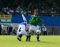 Photo: Andrew Unwin.<br />Northern Ireland v Azerbaijan. FIFA World Cup Qualifying match. 03/09/2005.<br />Azerbaijan's Makhmud Gurbanov (L) is upended as Northern Ireland's Keith Gillespie (R) controls the ball.