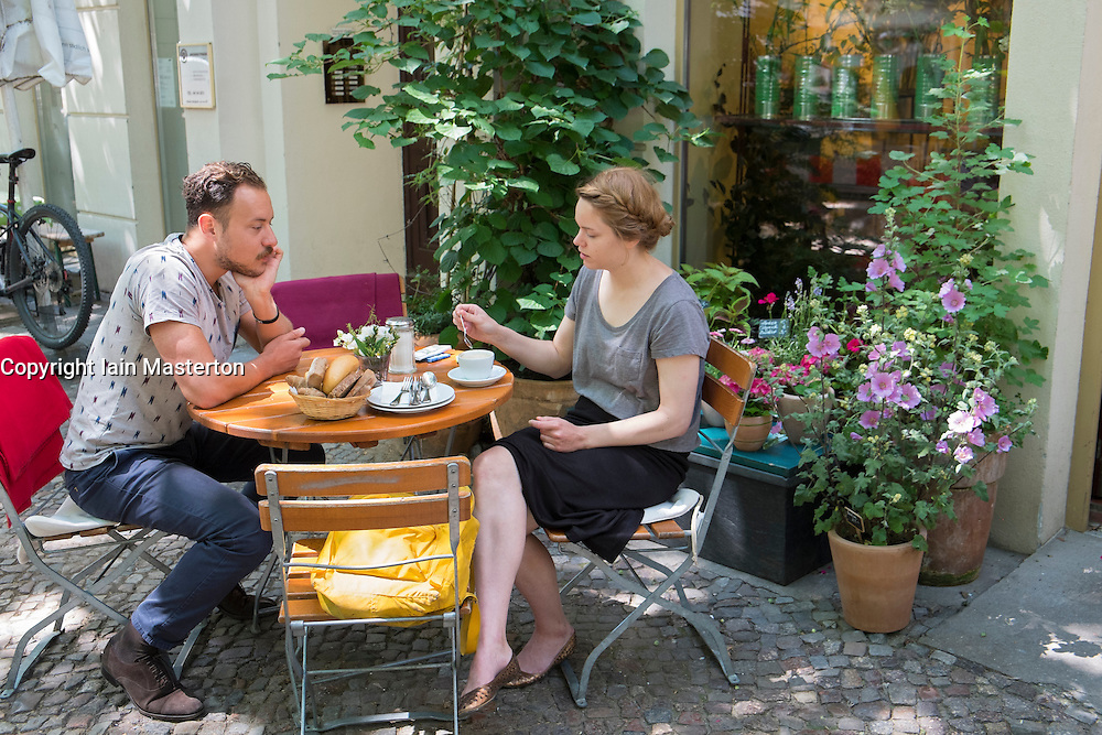 People having brunch at weekend at Anna Blume cafe in Prenzlauer Berg in Berlin Germany