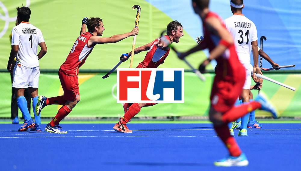 TOPSHOT - Belgium's Sebastien Dockier (C) celebrates a goal during the men's quarterfinal field hockey Belgium vs India match of the Rio 2016 Olympics Games at the Olympic Hockey Centre in Rio de Janeiro on August 14, 2016. / AFP / MANAN VATSYAYANA        (Photo credit should read MANAN VATSYAYANA/AFP/Getty Images)