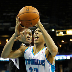 Jan 21, 2013; New Orleans, LA, USA; Sacramento Kings power forward Thomas Robinson (0) reaches in on New Orleans Hornets power forward Anthony Davis (23) during  the second quarter of a game at the New Orleans Arena. Mandatory Credit: Derick E. Hingle-USA TODAY Sports