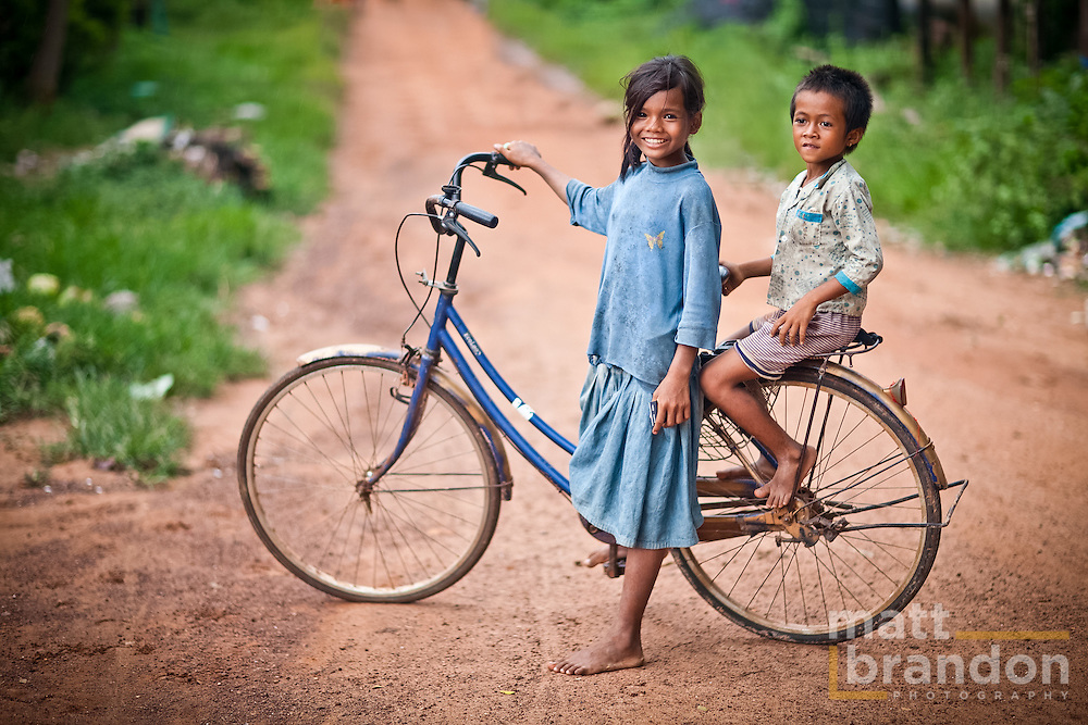 Cambodian children on a bicycle.
