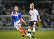 Jayden Stockley and Johnny Russell during the Capital One Cup match between Portsmouth and Derby County at Fratton Park, Portsmouth, England on 12 August 2015. Photo by Adam Rivers.
