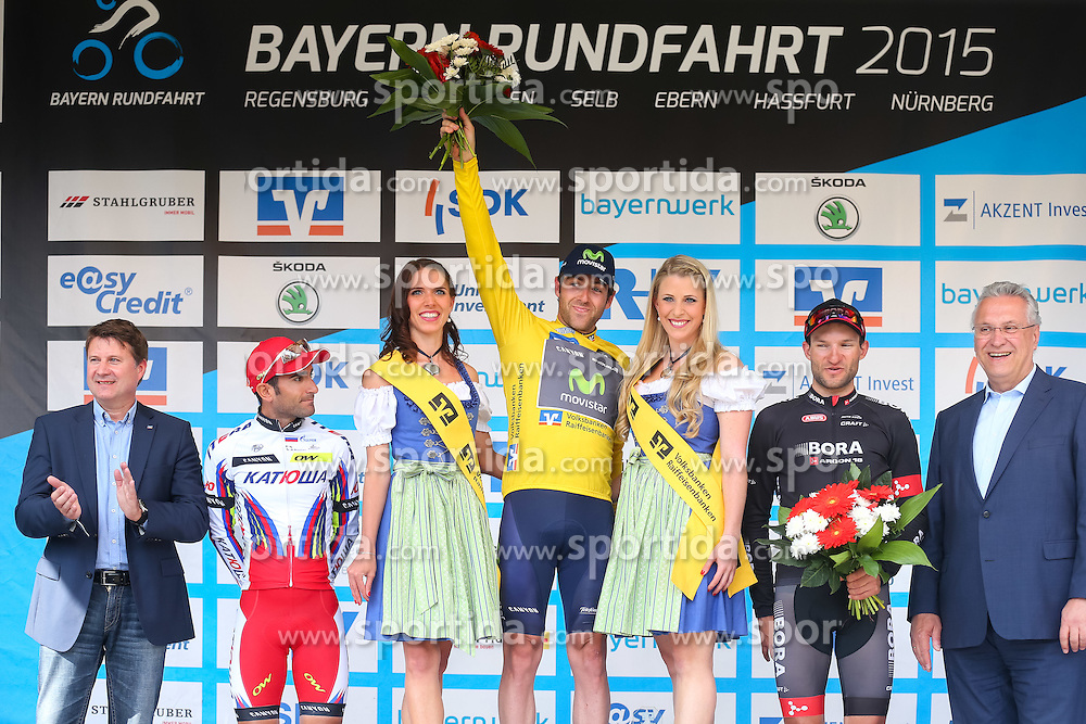 Radsport: 36. Bayern Rundfahrt 2015 / 5. Etappe, Hassfurt - Nuernberg, 17.05.2015<br /> Cycling: 36th Tour of Bavaria 2015 / Stage 5, <br /> Hassfurt - Nuernberg, 17.05.2015<br /> Siegerehrung - podium,<br /> # 45 Lagutin, Sergey (RUS, TEAM KATUSHA), # 32 Dowsett, Alex (GBR, MOVISTAR TEAM), Gelbes Trikot Gesamtfuehrender / Yellow Leader Jersey, # 112 Barta, Jan (CZE, Team BORA-ARGON 18)