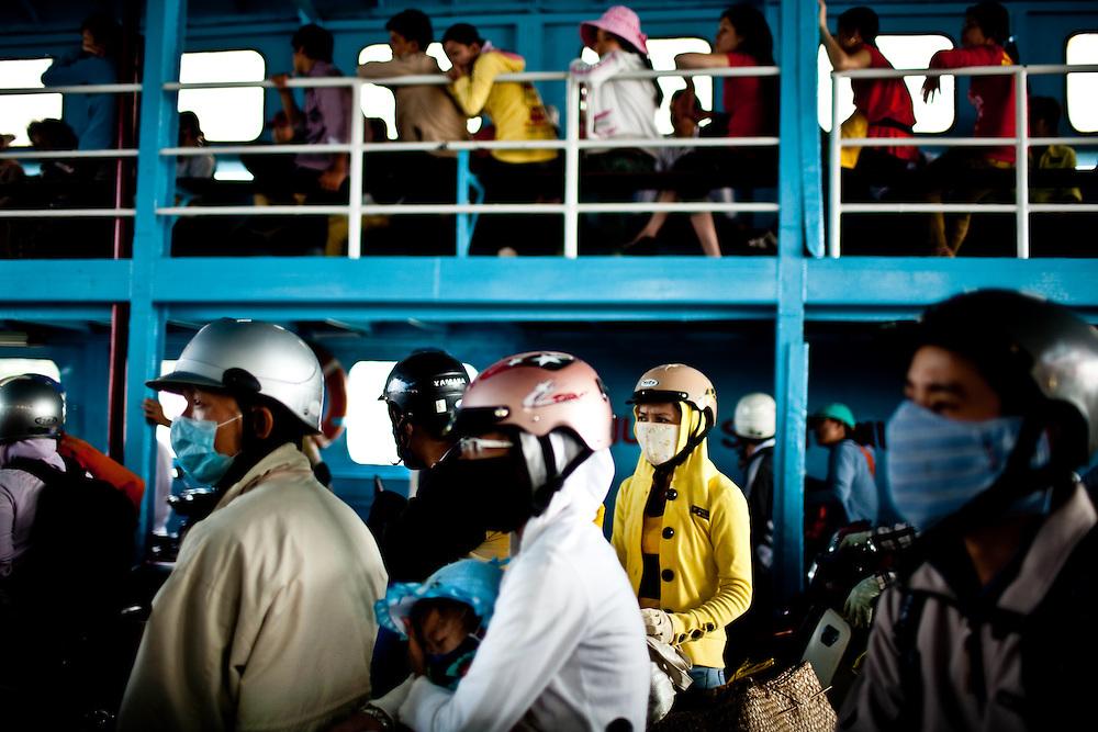 Passengers on a ferry in the Mekong Delta, Vietnam